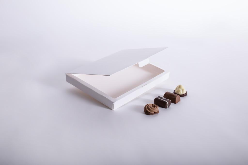 Faltschachtel mit Klappdeckel für Pralinen - Mugler Masterpack GmbH