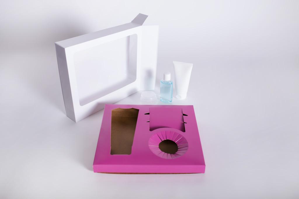 Verpackung mit einem Nest zur Produktfixierung - Mugler Masterpack GmbH